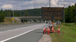 """A sign at a same-day COVID-19 vaccination clinic for commercial truckers in Delta clearly said """"first dose only,"""" but many people who drove up and dropped in on Wednesday were getting their second shots. (CTV)"""