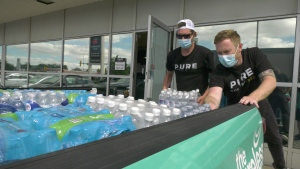 Pure Country Regina donated a truck full of water bottles to Regina's community fridges, in hopes of providing more people in the community safe, clean drinking water. (Andrew Benson/CTV News)