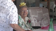 109-year-old Alma Miller wears a birthday crown at her birthday lunch (Kaylyn Whibbs/CTV News)