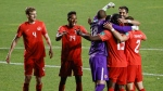 Canada players celebrate team's win 3-0 win over Haiti in a World Cup qualifying soccer match Tuesday, June 15, 2021, in Bridgeview, Ill. (AP / Kamil Krzaczynski)