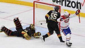 Montreal Canadiens right wing Paul Byron, right, celebrates after scoring on Vegas Golden Knights goaltender Marc-Andre Fleury (29) during the second period in Game 2 of an NHL hockey Stanley Cup semifinal playoff series, Wednesday, June 16, 2021, in Las Vegas. (AP Photo/David Becker)