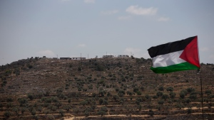 The the newly established hilltop Jewish outpost of Eviatar is seen from the Palestinian village of Beita, south of the West Bank city of Nablus, Monday, June 14, 2021. (AP Photo/Majdi Mohammed)