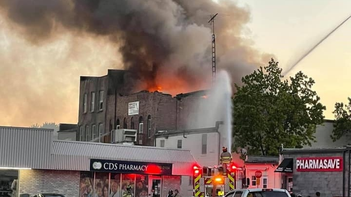 Flames are seen coming from the roof of a building in downtown Forest, Ont. on Wednesday, June 16, 2021. (Coutesy Madison Nethercott)