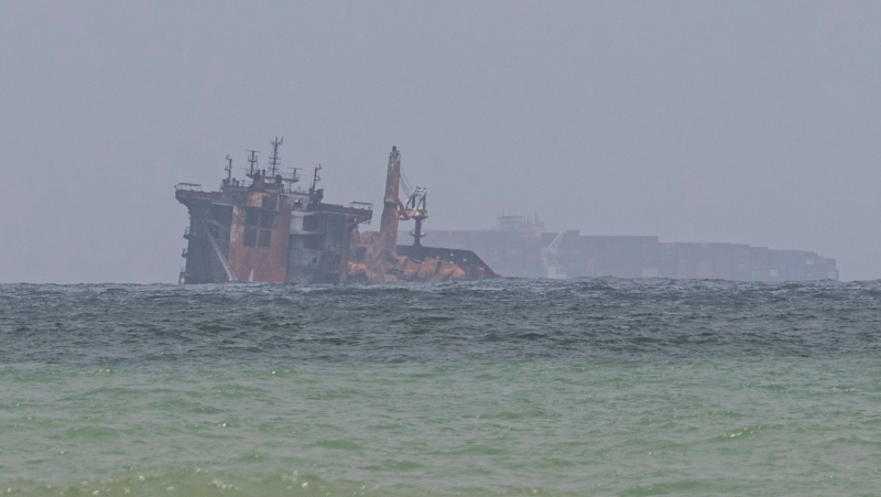 Fire-damaged container ship MV X-Press Pearl is seen partially sunk where it is anchored off Colombo port at Kapungoda, Sri Lanka, Friday, June 4, 2021.(AP Photo/Eranga Jayawardena)