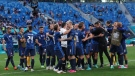 Slovakian players celebrate at the end of a Euro 2020 match against Poland in St. Petersburg, Russia, on June 14, 2021. (Evgenya Novozhenina / Pool via AP)