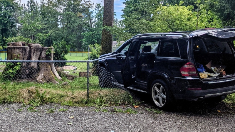 West Vancouver police say a woman was ticketed on June 15, 2021, after she drove through a fence at an elementary school. (West Vancouver police handout)