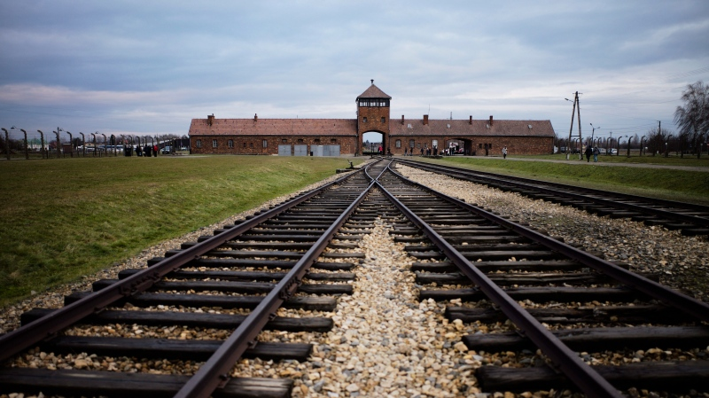 In this Dec. 7, 2019, photo, railway tracks from where where hundreds of thousands of people were directed to the gas chambers directed to the gas chambers to be murdered, inside the former Nazi death camp of Auschwitz Birkenau or Auschwitz II, in Oswiecim, Poland. (AP Photo/Markus Schreiber, File)