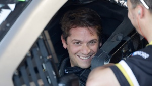 Landon Cassill smiles from his car after practice for a NASCAR auto race Friday, Aug. 30, 2019, in Darlington, S.C.. (AP Photo/Terry Renna)