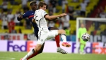 France's Paul Pogba, left, challenges Germany's Thomas Mueller during the Euro 2020 soccer championship group F match between Germany and France at the Allianz Arena stadium in Munich, Tuesday, June 15, 2021. (Franck Fife/Pool via AP)