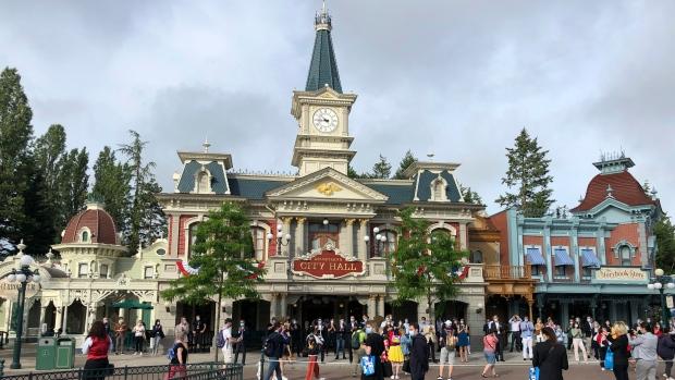 Visitors wait to enter Disneyland Paris in Marne-la-Vallée, east of Paris, Thursday, June 17, 2021. (AP Photo/Catherine Gaschka)