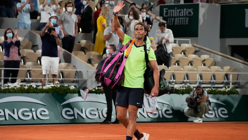 Spain's Rafael Nadal waves after losing to Serbia's Novak Djokovic in their semifinal match of the French Open tennis tournament at the Roland Garros stadium Friday, June 11, 2021 in Paris. (AP Photo/Michel Euler)