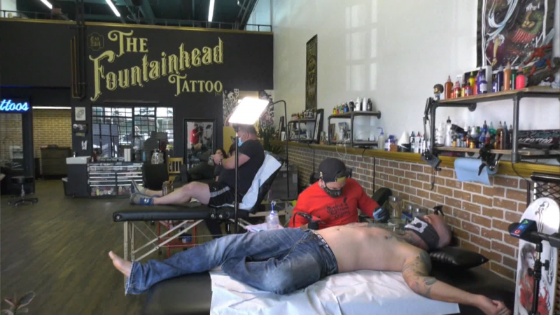 Shan Claydon at The Fountainhead Tattoo shop in Edmonton offered to help Erik Smith, who was looking to cover up his swastika and other racist tattoos.