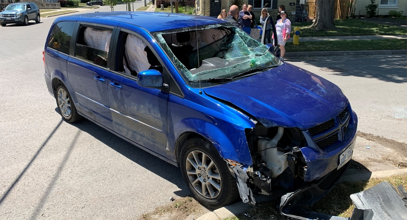 A damaged minivan is seen after a rollover crash in east London, Ont. on Thursday, June 17, 2021. (Bryan Bicknell / CTV News)