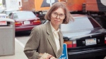 The New Yorker writer Janet Malcolm leaves the Federal Courthouse in San Francisco on June 3, 1993 in the suit trial brought by psychoanalyst Jeffrey Masson, who claims he was misquoted and libeled in a 1983 magazine article. Malcolm, the inquisitive and boldly subjective author and reporter known for her challenging critiques of everything from murder cases and art to journalism itself, has died. She was 86. Malcolm's death was confirmed Thursday by a spokesperson for The New Yorker, where Malcolm was a longtime staff writer. (AP Photo/George Nikitin, File)