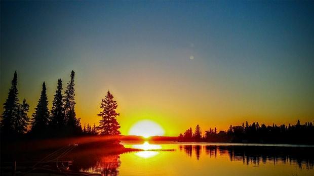 Sunrise at Falcon Lake. Photo by Martha Heinrichs.
