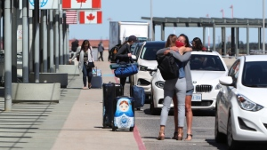 Travellers arrive at the departures level of the Ottawa MacDonald-Cartier International Airport on Wednesday, June 16, 2021. (David Kawai/THE CANADIAN PRESS)