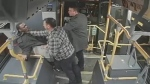 Surveillance video presented in court shows two plainclothes police officers grabbing a young Black man on the TTC. (Court exhibit)