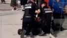 A video posted to social media shows a Montreal police officer putting his left knee on a young Black man's neck and face. (La Presse)