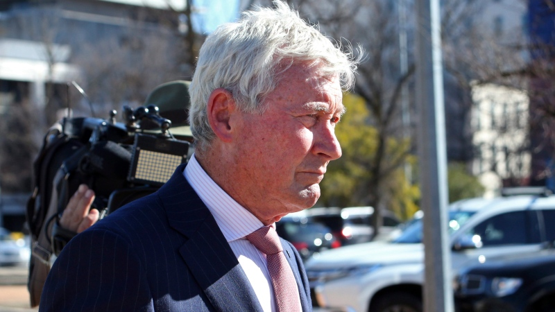 Lawyer Bernard Collaery walks from the Australian Capital Territory Magistrates Court in Canberra on Tuesday, July 30, 2019, after appearing on charges that he and a former spy conspired to communicate secret information concerning allegations that Australia bugged East Timor's Cabinet in 2004. (AP Photo/Rod McGuirk)
