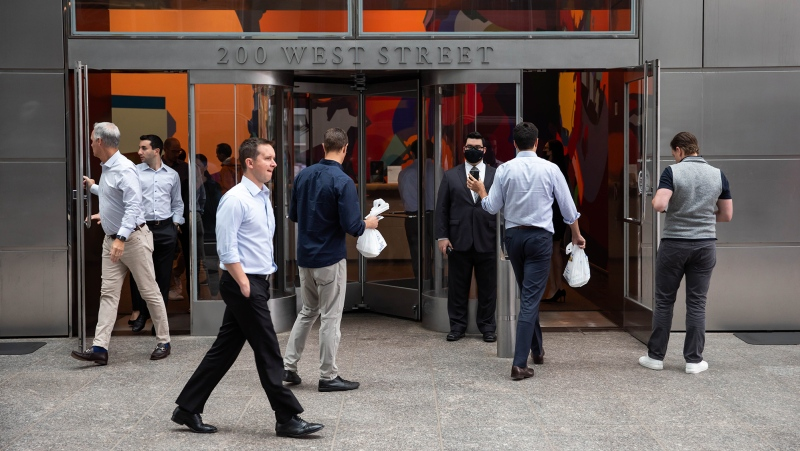 People enter the Goldman Sachs headquarters building in New York on Monday, June 14. (Michael Nagle/Bloomberg/Getty Images/CNN)