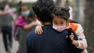 Heading to a kindergarten in Beijing on June 9, 2021. (Andy Wong / AP)