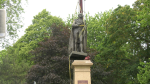 Crews remove a statue of Sir John A. Macdonald from City Park in Kingston, Ont. on Friday. (Kimberley Johnson/CTV News Ottawa)