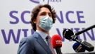 Canada's Prime Minister Justin Trudeau speaks during a visit to the Pfizer pharmaceutical company in Puurs, Belgium, Tuesday, June 15, 2021. Canadian Prime Minister Justin Trudeau paid a visit to the Belgian Pfizer factory on Tuesday to thank employees making the COVID-19 vaccine. (Frederic Sierakowski, Pool via AP)