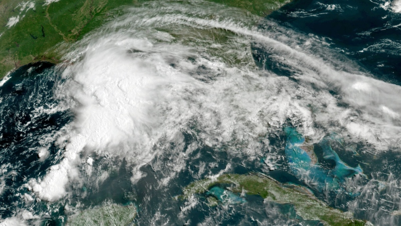 This GOES-16 GeoColor satellite image taken Friday, June 18, 2021, at 11 a.m. EDT, and provided by NOAA, shows a tropical weather system in the Gulf of Mexico. Officials ordered a floodgate and locks system closed in southeast Louisiana and readied sandbags in Mississippi and Alabama as a broad, disorganized tropical weather system began spinning bands of rain and brisk wind across the northern Gulf of Mexico coast Friday. (NOAA via AP)