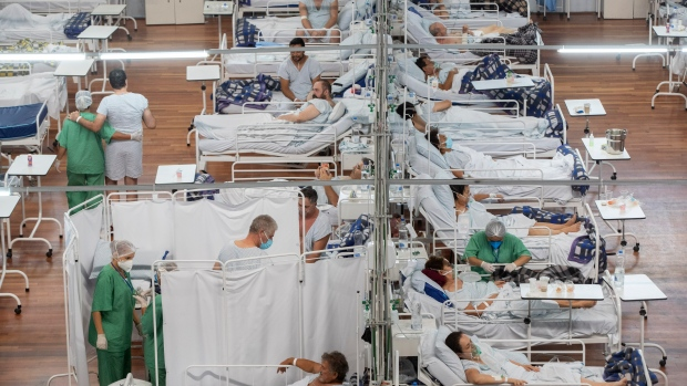 In this March 4, 2021 file photo, patients infected with COVID-19 fill the beds at a field hospital built inside a sports coliseum in Santo Andre, Brazil, on the outskirts of Sao Paulo, Brazil. As Brazil hurtles toward an official COVID-19 death toll of 500,000, its Senate is publicly investigating how the pandemic death toll got so high, focusing on why the government ignored opportunities to buy vaccines while pushing hydroxychloroquine. (AP Photo/Andre Penner, File)