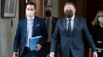Quebec Premier Francois Legault, right, and Quebec Justice Minister Simon Jolin-Barrette, responsible for language law, walk to a news conference after tabling a reform on language law, Thursday, May 13, 2021 at the legislature in Quebec City. THE CANADIAN PRESS/Jacques Boissinot