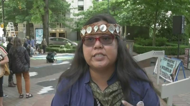 Activists protest TMX pipeline insurance