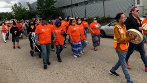 Students and staff from the Saskatoon campus of the First Nations University of Canada organized a walk for truth and reconciliation on Friday morning.