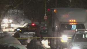 Police vehicles and yellow caution tape surrounds a William Street home in Barrie, Ont. after the bodies of two men are found inside on Feb. 8, 2017. (CTV News Barrie)