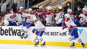 Montreal Canadiens team members celebrate after the team defeated the Vegas Golden Knights 3-2 in Game 2 of an NHL hockey Stanley Cup semifinal playoff series, Wednesday, June 16, 2021, in Las Vegas. (AP Photo/John Locher)