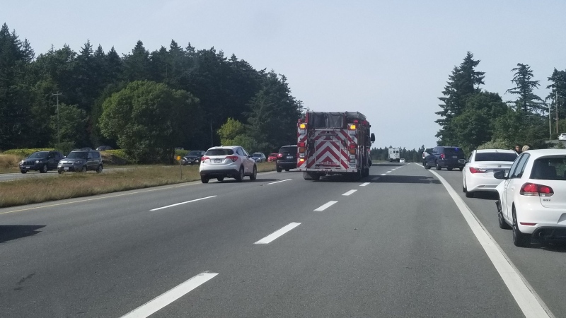 Saanich police say both northbound lanes of the highway are currently closed, by vehicles can drive on the shoulder of the highway to move around the crash site: (Saanich Police Traffic Safety Unit / Twitter)