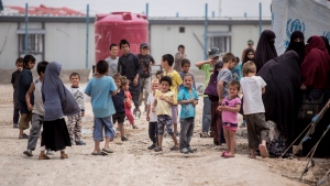 Women and children gather in front their tents at al-Hol camp that houses some 60,000 refugees, including families and supporters of the Islamic State group, many of them foreign nationals, in Hasakeh province, Syria, Saturday, May 1, 2021. (AP Photo/Baderkhan Ahmad)