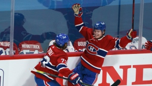 Montreal Canadiens' Cole Caufield celebrates his goal with teammate Tyler Toffoli as they face the Vegas Golden Knights during second period of Game 3 of the NHL Stanley Cup semifinal Friday, June 18, 2021 in Montreal. THE CANADIAN PRESS/Paul Chiasson