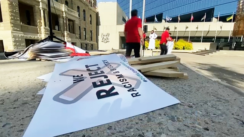 Some members of Calgary's Muslim community staged a rally Friday outside city hall