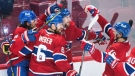 Montreal Canadiens' Josh Anderson (17) celebrates with teammates after scoring against the Vegas Golden Knights during the third period in Game 3 of the NHL Stanley Cup semifinal in Montreal, Friday, June 18, 2021. THE CANADIAN PRESS/Graham Hughes