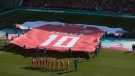 A giant jersey in support of Danish player Christian Eriksen is displayed ahead of the Euro 2020 soccer championship group B match between Denmark and Belgium at the Parken stadium in Copenhagen, Denmark, Thursday, June 17, 2021. Christian Eriksen was hospitalized after collapsing during Denmarks match with Finland. (Hannah McKay/Pool via AP)