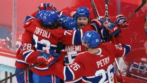 Montreal Canadiens' Josh Anderson is surrounded by teammates after scoring the winning goal to defeat the Vegas Golden Knights in overtime of Game 3 of the NHL Stanley Cup semifinal Friday, June 18, 2021 in Montreal. THE CANADIAN PRESS/Paul Chiasson