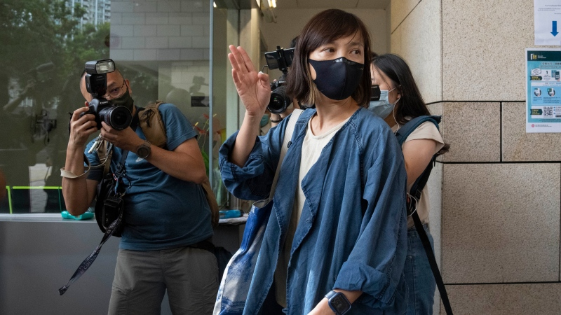 Chan Pui-man, deputy editor of the Apple Daily newspaper, walks out from court in Hong Kong, Saturday, June 19, 2021. A Hong Kong court ordered the top editor of pro-democracy newspaper Apple Daily and the head of its parent company held without bail Saturday in the first hearing since their arrest two days ago under the city's national security law. (AP Photo/Kin Cheung)