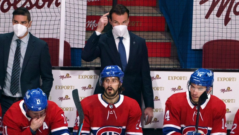Montreal Canadiens replacement coach Luke Richardson is seen behind the team bench as they face the Vegas Golden Knights during first period of Game 3 of the NHL Stanley Cup semifinal Friday, June 18, 2021 in Montreal. THE CANADIAN PRESS/Paul Chiasson