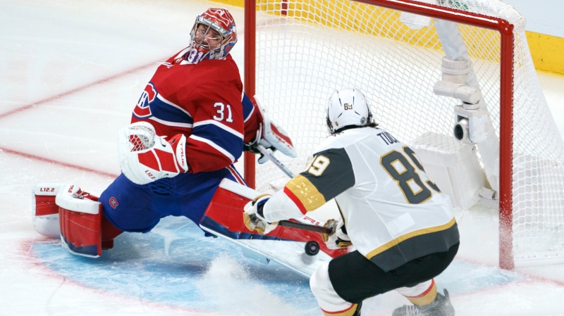 Montreal Canadiens goaltender Carey Price makes a save off Vegas Golden Knights' Alex Tuch during third period of Game 3 of the NHL Stanley Cup semifinal Friday, June 18, 2021 in Montreal. THE CANADIAN PRESS/Paul Chiasson