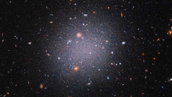 NGC1052-DF2 is seen in this undated image from the Hubble Space Telescope. (NASA, ESA, Z. Shen and P. van Dokkum (Yale University), and S. Danieli (Institute for Advanced Study)