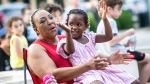 Doris Watkins, left, claps with her granddaughter, Zawadi Odhiambo, 4, during the Juneteenth: Freedom Day Block Party outside the Lauderdale County Courthouse on Friday, June 18, 2021 in Florence, Ala. (Dan Busey/The TimesDaily via AP)