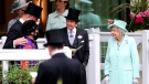 Britain's Queen Elizabeth II, right, talks to Frankie Dettori, left and trainer John Gosden, background left , during day five of the Royal Ascot horserace meeting, at Ascot Racecourse, in Ascot, England, Saturday June 19, 2021. (David Davies/PA via AP)