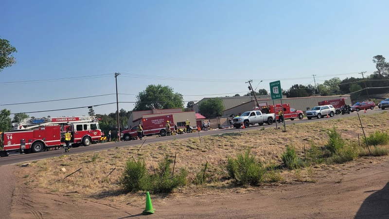 First responders on the scene of an incident in Show Low, Arizona, where police say a suspect used a vehicle to strike at least 9 cyclists on Saturday, June 19. (Timber Mesa Fire and Medical District/Facebook/CNN)