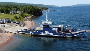 Passengers disembark Englishtown Ferry at Jersey Cove, Victoria County to connect to highway 312. (Photo: Nova Scotia Government)