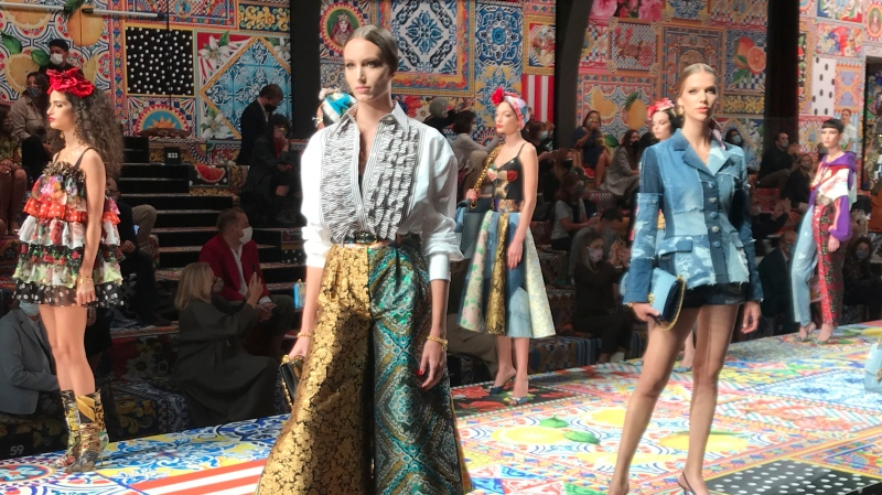 Models wear creations as part of the Dolce & Gabbana 2021 women's spring-summer ready-to-wear collection during the Milan's fashion week in Milan, Italy, Wednesday, Sept. 23, 2020. (AP Photo/Colleen Barry)